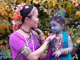 Little Krishna and dancer in pose